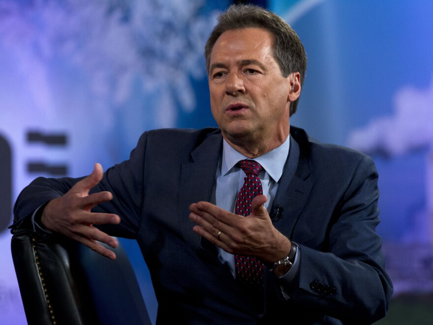 Montana Gov. Steve Bullock, seen last September, has announced a plan to reopen the state's businesses now closed because of the coronavirus.