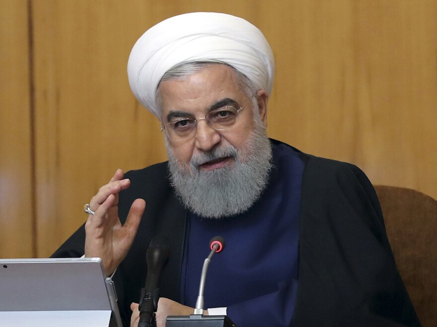 Iranian President Hassan Rouhani says Iran will begin keeping its excess uranium and heavy water, and he set a 60-day deadline for new terms to its nuclear deal before the country will resume higher uranium enrichment. Rouhani is seen here at a cabinet meeting in Tehran on Wednesday.