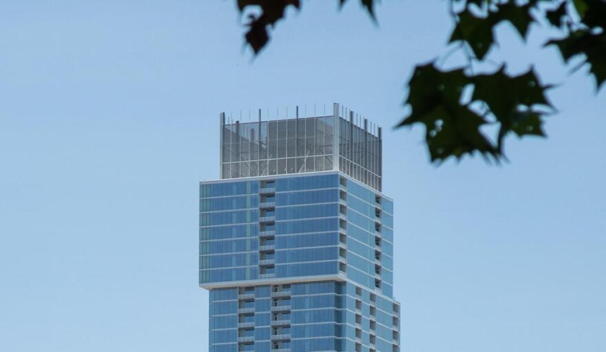 The top of the Independent in downtown Austin, as seen during the day.