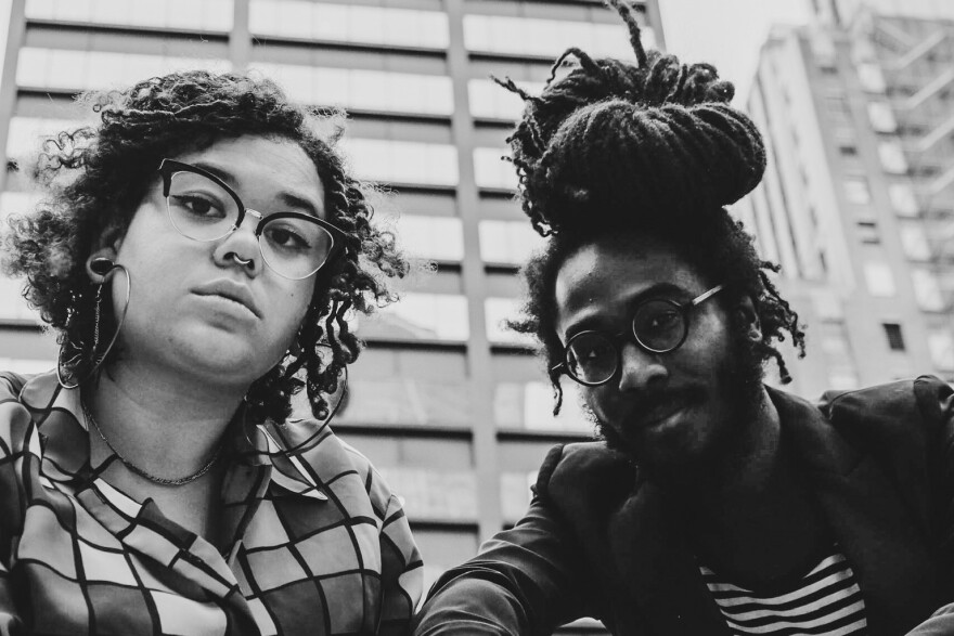 A black-and-white photo of Jade Green and Xavier, the musicians behind Kansas City hip-hop group the Black Creatures.