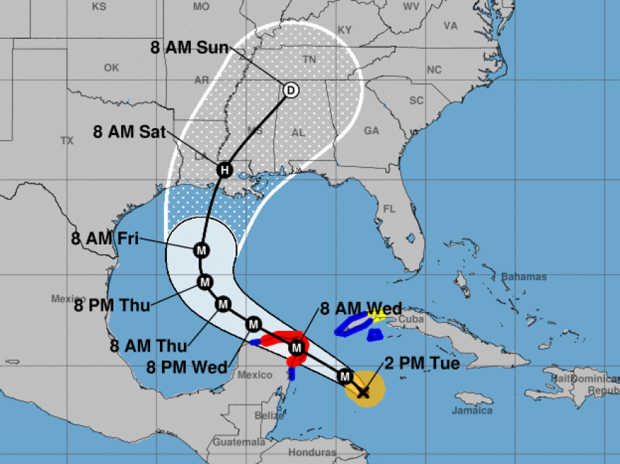 Hurricane Delta will pass over part of the Yucatan Peninsula before heading toward the Gulf Coast, where it's forecast to make landfall on the Louisiana coast late this week.