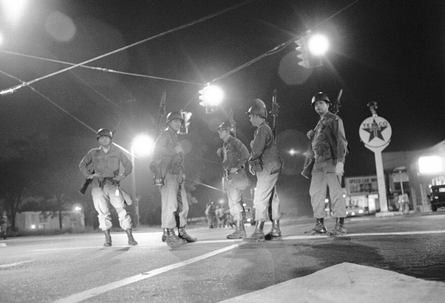 Georgia National Guard troops stand at an intersection at the edge of the riot-torn area of town in Augusta, Ga., on May 12, 1970. More than 100 blocks of neighborhoods and businesses — about 7 miles — were ransacked and vandalized. Police killed six Black men.