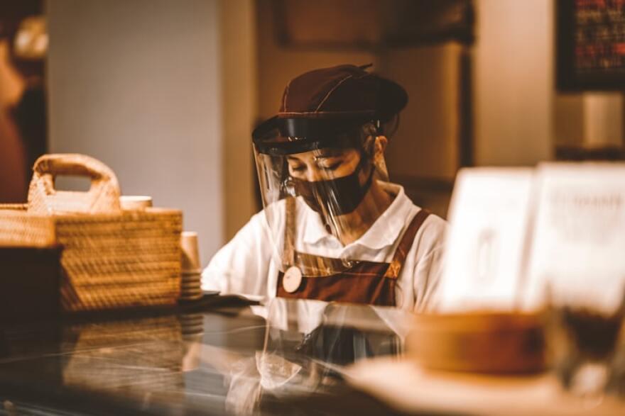 Masked restaurant worker
