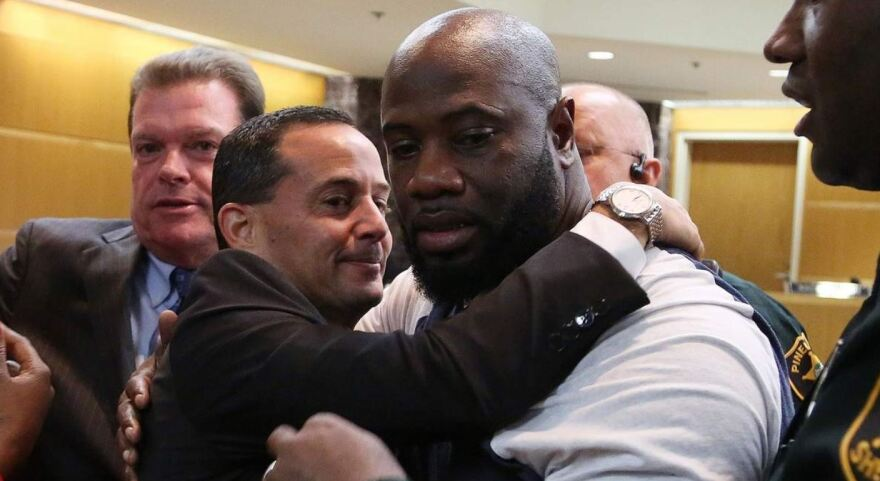 Michael McGlockton, right, is embraced by assistant state attorney Scott Rosenwasser following the verdict.