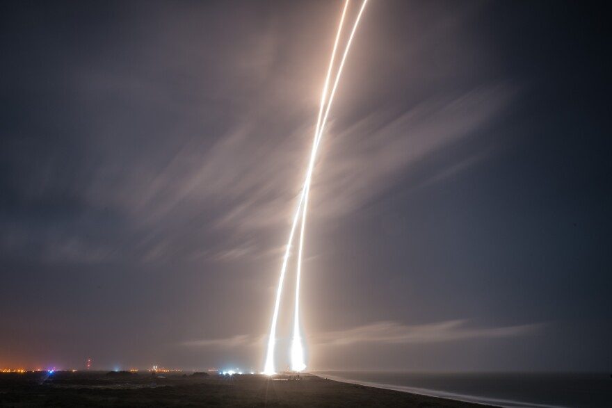 A handout picture made available by SpaceX shows a nine-minute exposure picture of the launch, re-entry and landing burns of SpaceX's Falcon 9 rocket at Cape Canaveral Air Force Station.