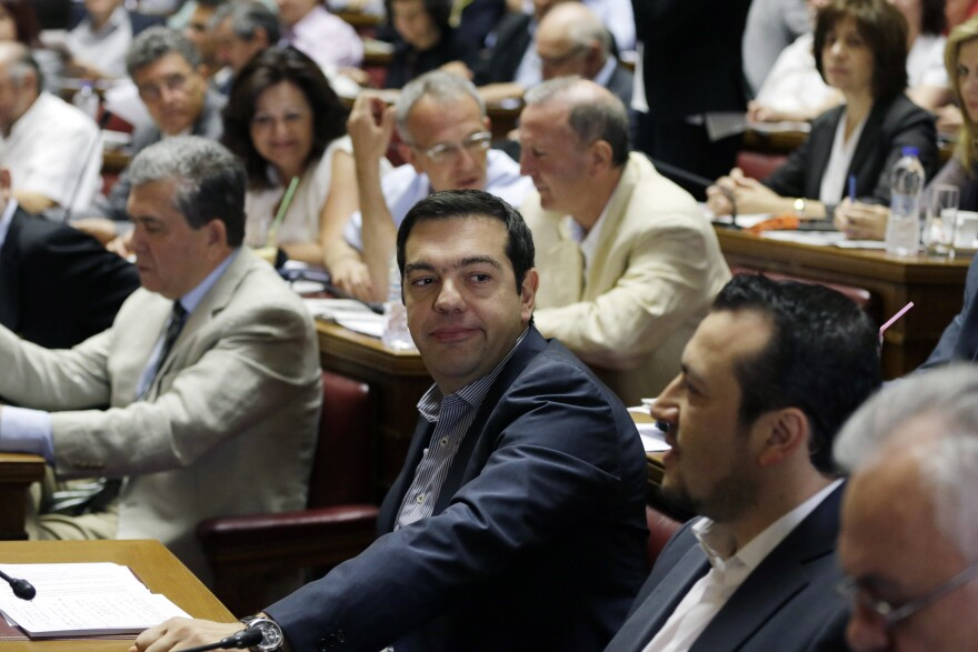 Greece's Prime Minister Alexis Tsipras attends a meeting with lawmakers of Syriza party at the Greek Parliament in Athens on Friday.