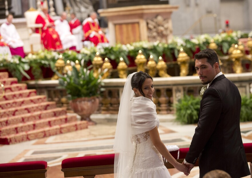 Sara Pisano (left) and Danilo Spagnoli, just married by Pope Francis, smile during the wedding ceremony in St. Peter's Basilica at the Vatican, Sept. 14. Pope Francis married 20 couples on Sunday, including some who already live together or and who already have children, both technically sins in the eyes of the church.