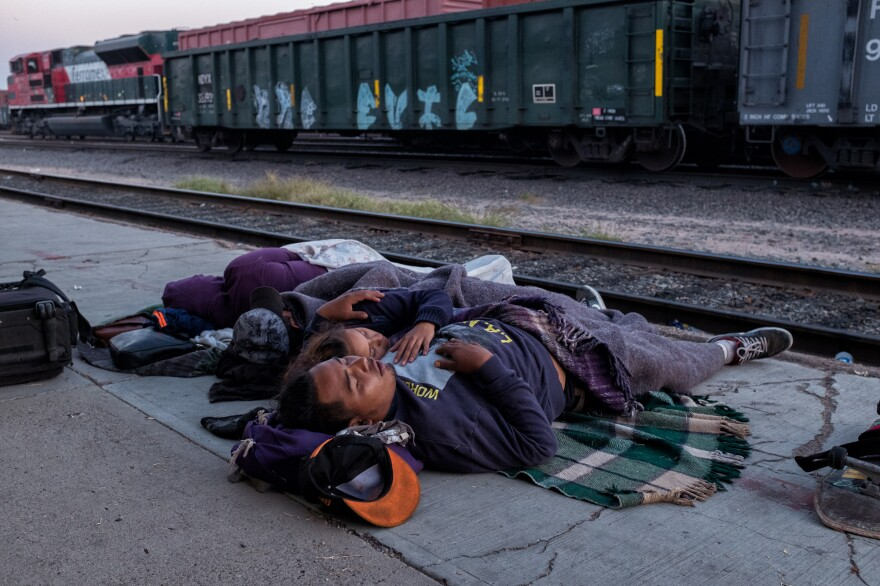 Refugee caravan members sleep near the railroad tracks in Sonora. On April 9, 2017, a group of Central Americans from Guatemala, El Salvador, Honduras and Nicaragua joined to form the 2017 Refugee Caravan, or <em>Viacrucis 2017,</em> put together by organizations from Mexico and the U.S.