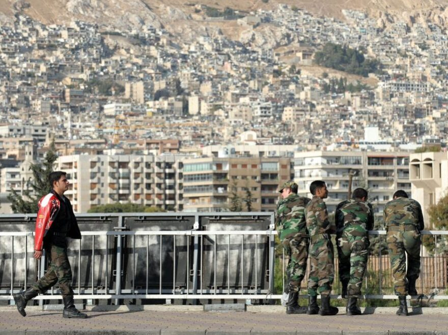 While fighting continues in Syria, the government has been detaining many nonviolent activists, according to monitoring groups. Here, Syrian soldiers are shown on a bridge in Damascus last November.