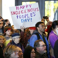 People look on at a celebration of Indigenous Peoples' Day in 2016 at Seattle's City Hall. Seattle began observing Indigenous Peoples' Day two years earlier to promote the well-being and growth of Seattle's Indigenous community.