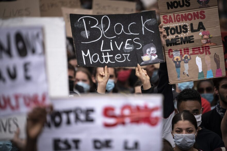 A demonstrator holds up a placard reading 'Black Lives Matter' in Toulouse, France, during a protest against police violence and in memory of late US citizen George Floyd as well as French citizen Adama Traore.
