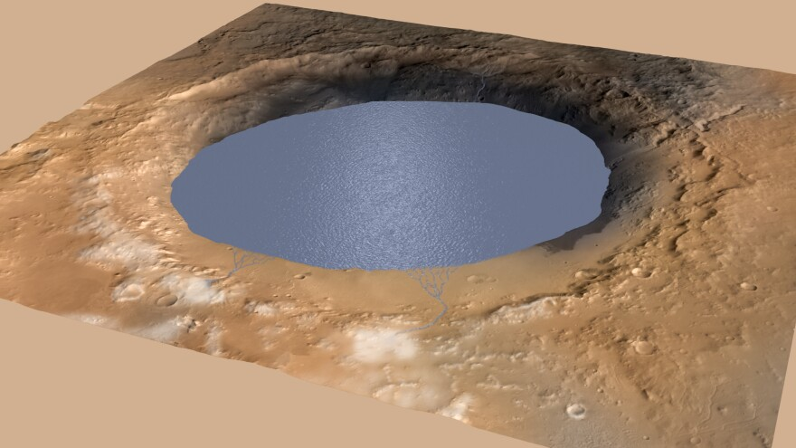 A simulated image shows a lake in the large Gale Crater on Mars, with streams of water flowing into it. NASA researchers believe a lake deposited enough sediment in the crater to form a mountain, Mount Sharp.