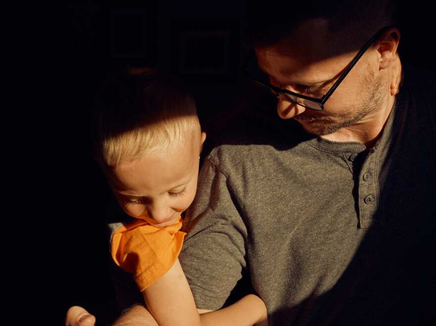 Jeremy Zuger with his son, Liam, in their home.