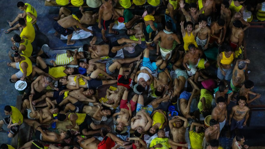 Prison inmates gather in cramped conditions in Manila's Quezon City Jail. Guards and inmates at the notoriously overcrowded Philippine jail tested positive for the COVID-19 coronavirus, officials said last month, sparking urgent calls for the release of some prisoners.