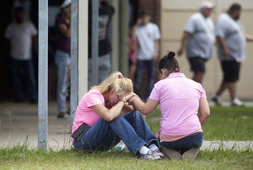 A middle school served as a reunion point for parents and students after a gunman killed 10 people at Santa Fe High School in 2018.