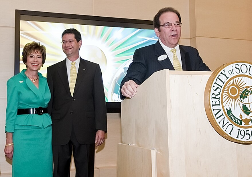 Judy Genshaft and her husband, Steven Greenbaum, watch as USF Foundation CEO Joel Momberg announces the couple's $1 million gift to fund study abroad scholarships in Feb. 2011.