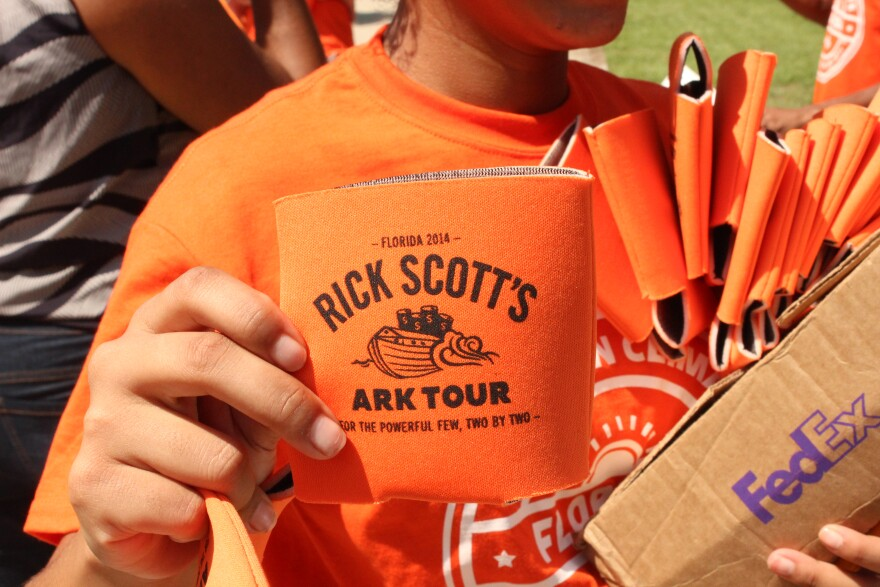 """NextGen handed out beer cozies at the Tallahassee """"Ark Tour"""" event. Most of the volunteers were college students."""