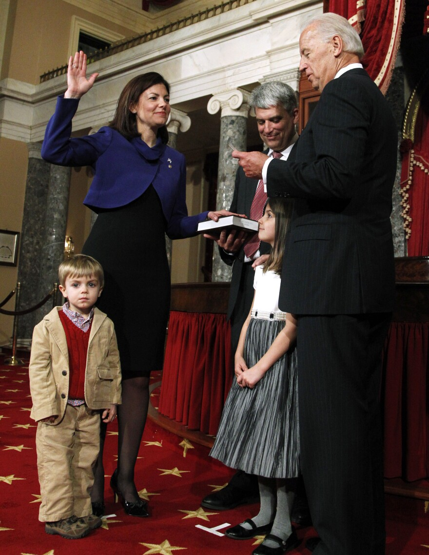 Vice President Joe Biden conducts a ceremonial swearing in for Ayotte as U.S. senator on Jan. 5, 2011, in the Capitol. With Ayotte are her husband and children.