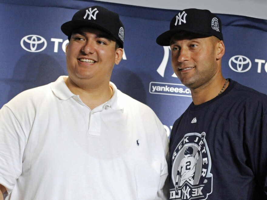 New York Yankees' Derek Jeter, right, and Christian Lopez  at a news conference on Saturday (July 9, 2011) at Yankee Stadium.
