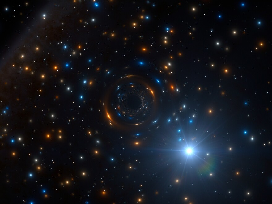 Astronomers have discovered a star, shown in an artist's rendition, that appears to be orbiting an invisible black hole with about four times the mass of the sun.