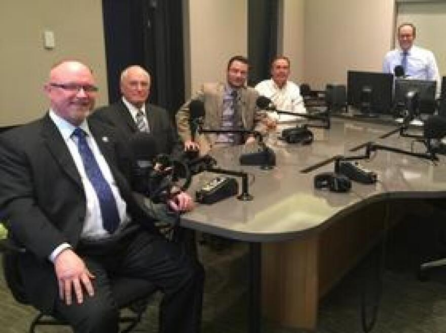 Former Florida Insurance Commissioner Kevin McCarty, Citizens Property Insurance CEO Barry Gilway, Florida Insurance Commissioner David Altmaier, Florida CFO Jeff Atwater join Tom Hudson (left to right) in the WLRN studios.