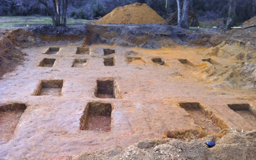 Empty burial sites at the site of the Dozier School for Boys, where researchers say they have found the remains of 55 children. For years, the reform school was notorious for the brutal treatment of its inmates.