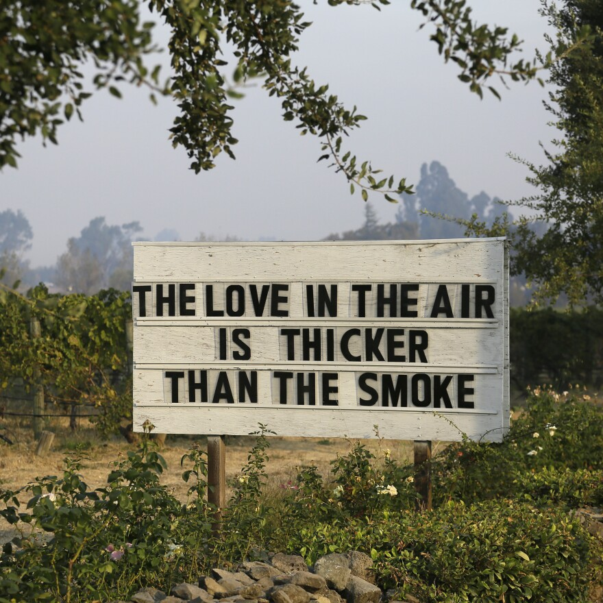 A sign in a vineyard outside the Cline Cellars winery shares a note of optimism on Monday in Sonoma, Calif.