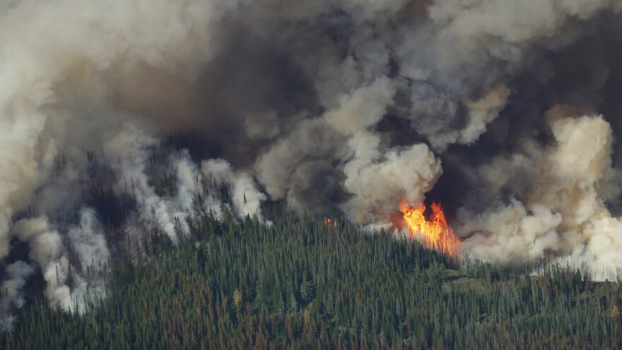 Smoke and flames rise from the Chiwaukum Creek Fire near Leavenworth, Wash., Thursday.