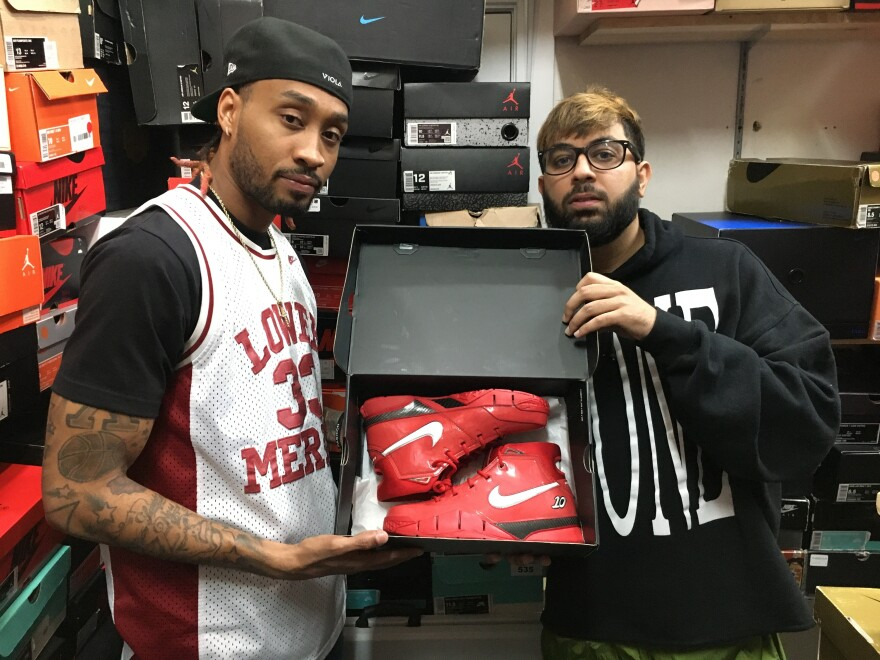 Davon Artis and Adeel Shams show off a pair of Kobe 1 Protro DeMar DeRozan shoes. The shoes are now worth thousands to collectors.