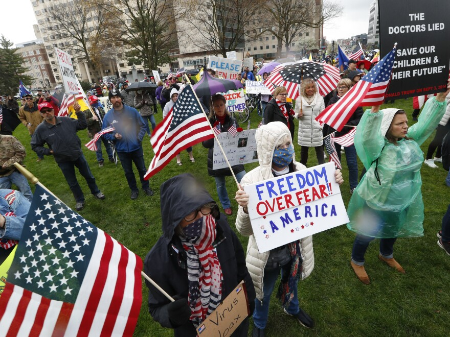 Anti-lockdown protesters rally at the state capitol in Lansing, Mich., on Thursday.
