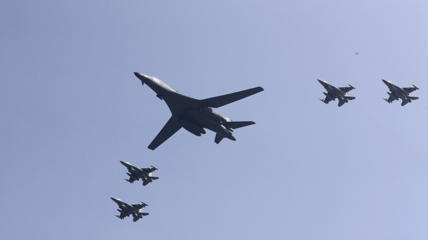A U.S. B-1B Lancer, escorted by fighter jets, flies over Osan Air Base in Pyeongtaek, South Korea, on Tuesday.