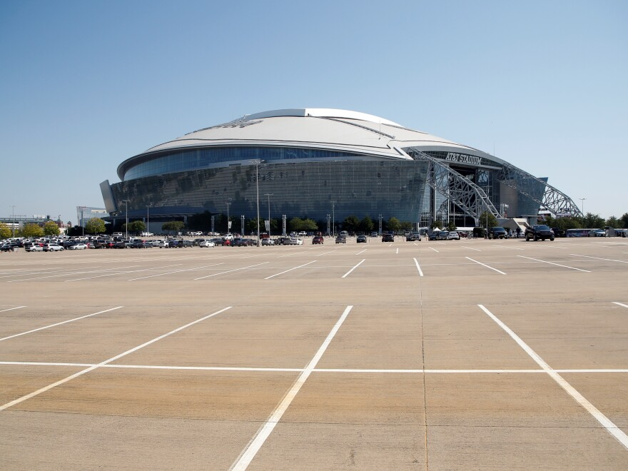The exterior of AT&T Stadium is shown in this general, overall view before an NFL football game between the Dallas Cowboys and the New York Giants in Arlington, Texas, Sunday, Oct. 11, 2020. (AP Photo/Michael Ainsworth)