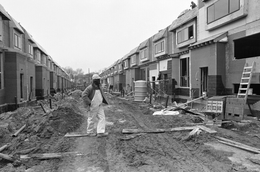 A workman walks down Osage Street on Dec. 5, 1985, amid continuing reconstruction in the neighborhood devastated by the deadly Philadelphia police confrontation with the group MOVE.