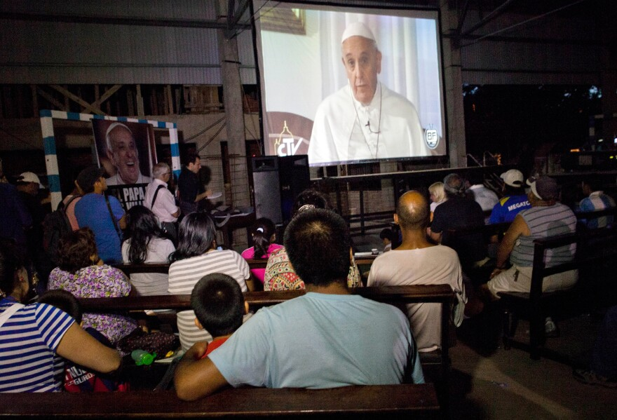 On the first anniversary of the pope's election in March 2013, people from the 1-11-14 slum in Buenos Aires, Argentina, celebrated a Mass in his honor and gathered to watch a local interview with him. While he was archbishop of Buenos Aires, Pope Francis was known for his close relationship with those he ministered to in the city's shantytowns.