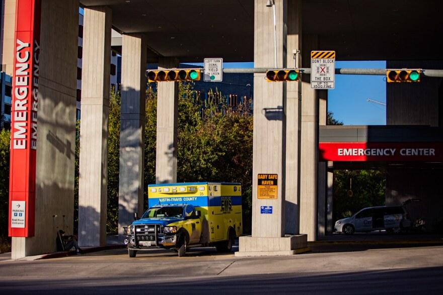 An ambulance leaves Dell Seton Medical Center in Austin.