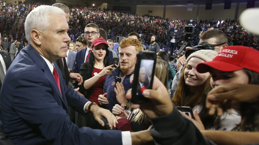 Republican vice presidential nominee Mike Pence, left, shakes the hands of supporters after a speech at Liberty University in Lynchburg, Va., on Oct. 12.
