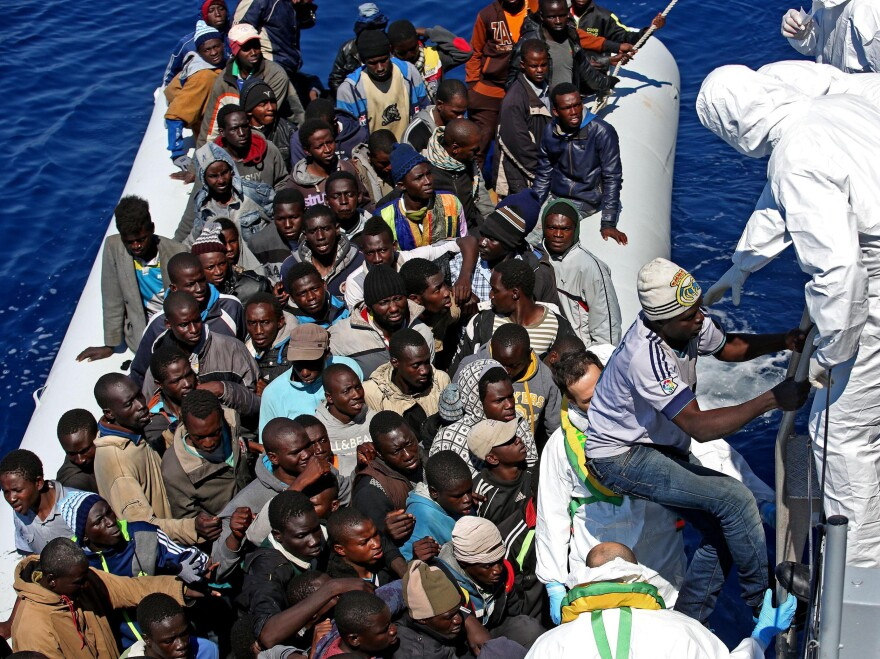 The Italian coast guard pulls migrants from an inflatable dinghy off the Libyan coast in the Mediterranean Sea last month. European Union leaders have submitted a plan of action to save lives in the Mediterranean.