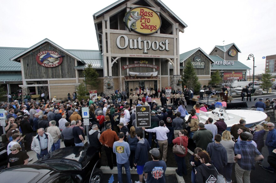 A crowd of people lined up ahead of the grand opening of a Bass Pro Shops Outpost store last year in Atlantic City, N.J.