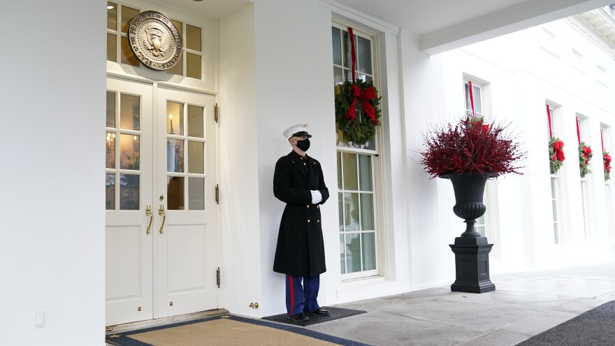 A marine stands outside the West Wing of the White House earlier this week. President Trump has been lobbied by advocates to use his powers to grant pardons and commutations ahead of leaving office.