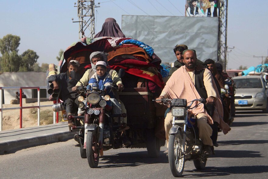 Afghans flee to Lashkar Gah, Helmand's provincial capital, during fighting between Taliban and Afghan security forces on Monday. Local authorities estimate that some 35,000 people have been displaced into Lashkar Gah since a Taliban offensive began in Helmand.