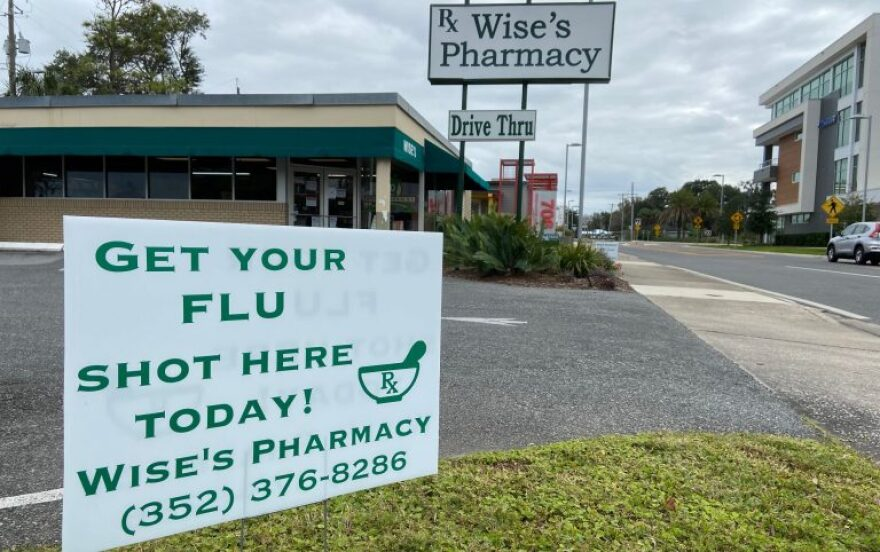 Wise's Pharmacy posts a sign at the entrance of their store, encouraging people to come in to get their flu shot.