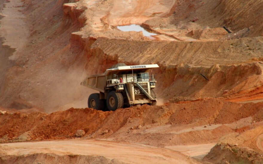 A driver operates a haul truck in the Ray Mine near Kearny, Ariz. Falling copper prices have residents of some small mining towns in Arizona worried as shrinking revenues bring layoffs.