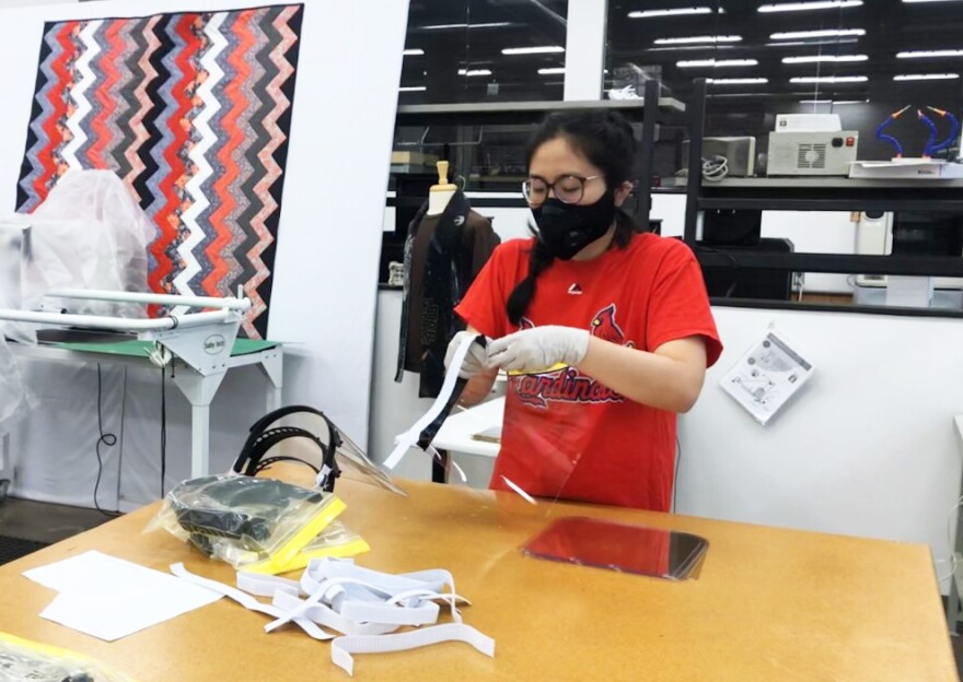 Kelsie Kodama, a first-year medical student at Washington University, assembles 3D-printed face shields at MADE in St. Louis.