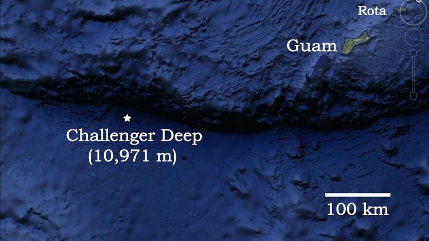 A map shows the location of the Pacific Ocean's Challenger Deep, in relation to Guam.