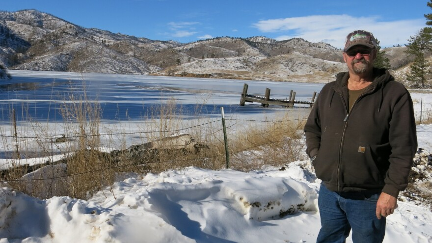Reservoir caretaker Doug Billingsley stands in his front yard — just yards away from the Milton Seaman Reservoir north of Fort Collins.