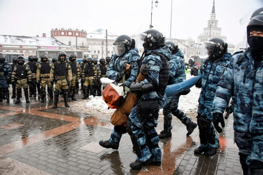 Riot police detain a man during a rally in support of jailed opposition leader Alexei Navalny in Moscow.