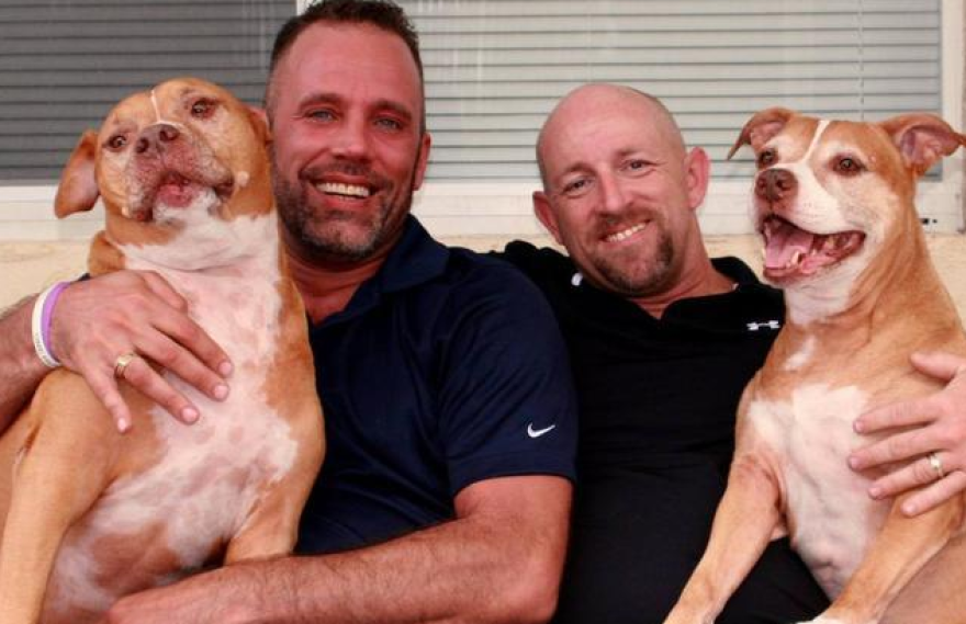 Aaron Huntsman and William Lee Jones at home with their dogs Riddick and Kira.