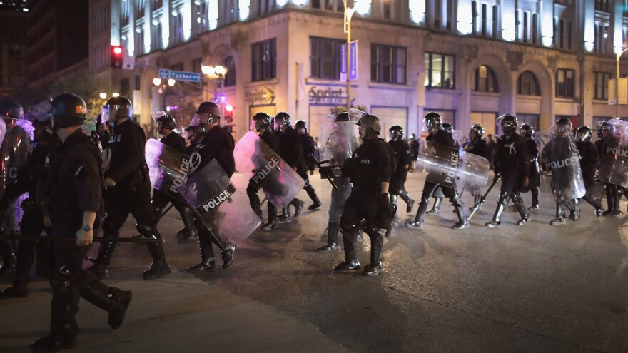 Police respond on Sept. 17, 2017, in St. Louis to demonstrators protesting the acquittal of former St. Louis police officer Jason Stockley, who had been charged with first-degree murder in a 2011 on-duty shooting. A federal grand jury on Thursday indicted three officers who responded to the protests in the beating of a fourth officer, who was working undercover that night.