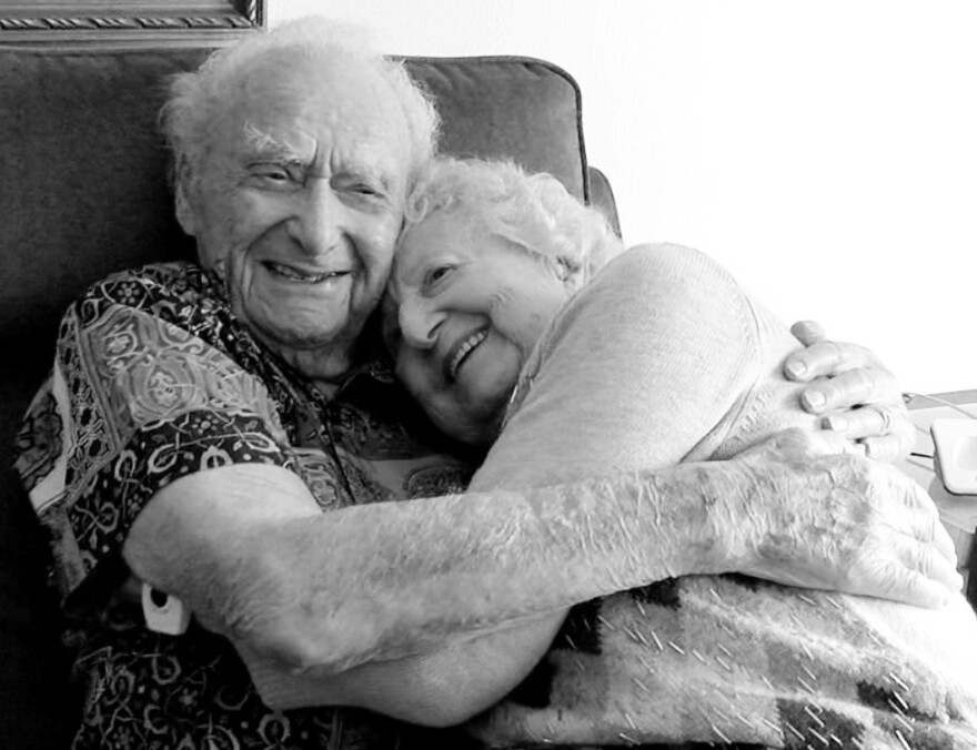 Joe Newman, 107, hugs his fiancée, Anita Sampson, who recently celebrated her 100th birthday with a party over Zoom.