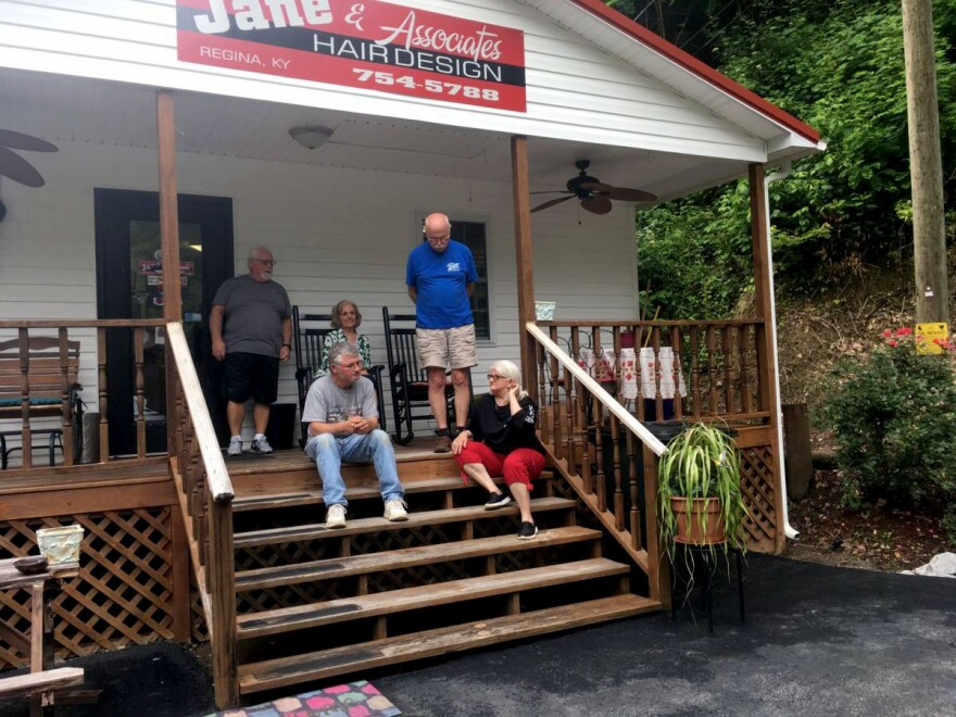 Todd Bentley's family and neighbor sit at the hair salon owned by his mother, Janie Caudill, on Harless Creek Road in June. From right to left are Janie and Bob Caudill, Judi Casalino, Bentley and Lonnie Matney, their neighbor.